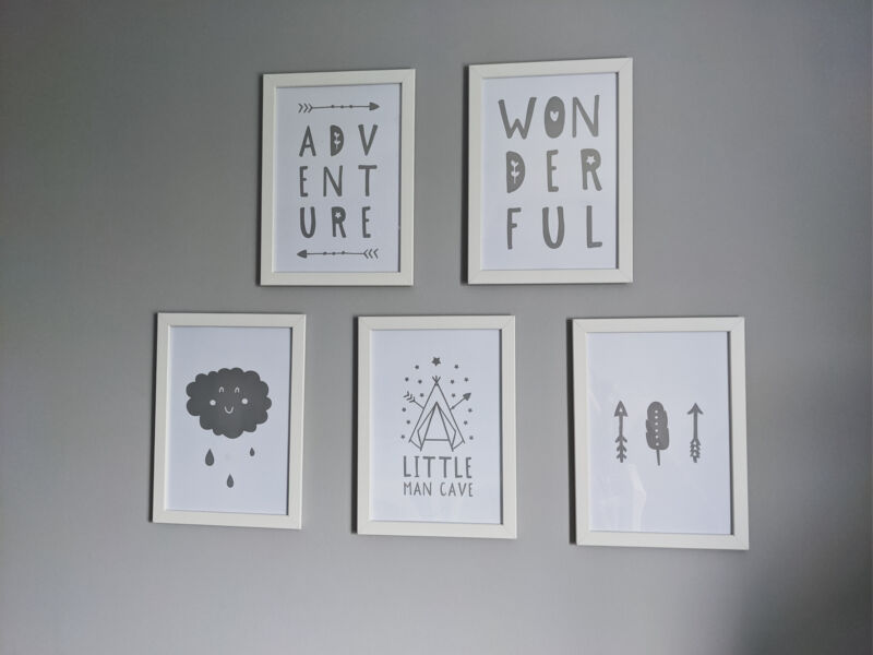 Grey and white prints framed on wall