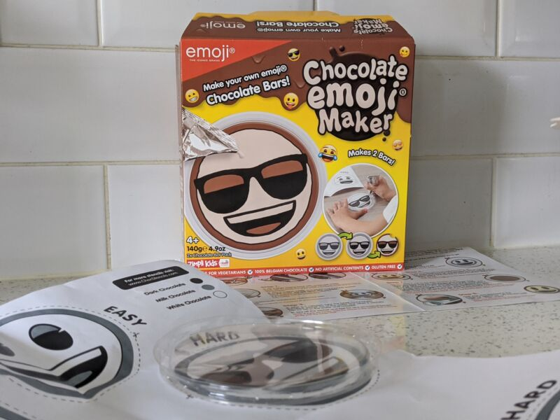 Chocolate emoji maker box with the tray and template in front of it