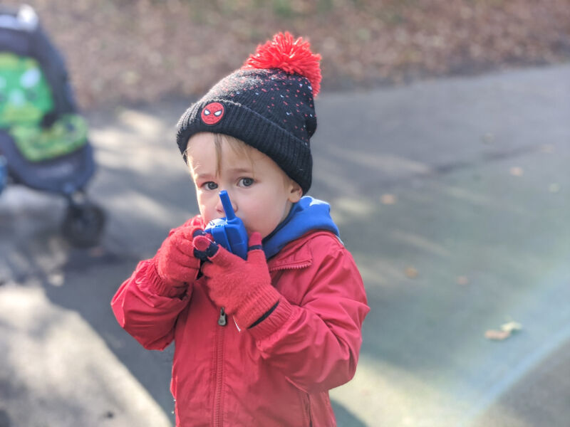 Dex using the Discovery walkie talkies in the park