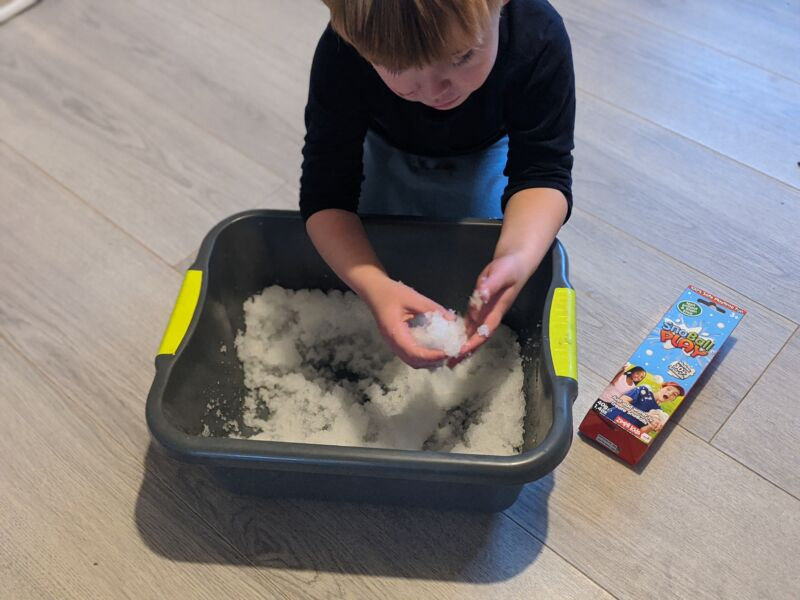 Dexter making snoballs using a washing up bowl