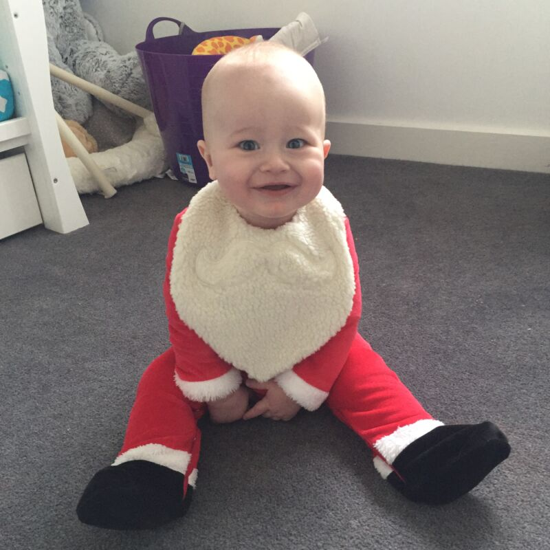Dexter dressed up on Christmas clothes at six months old
