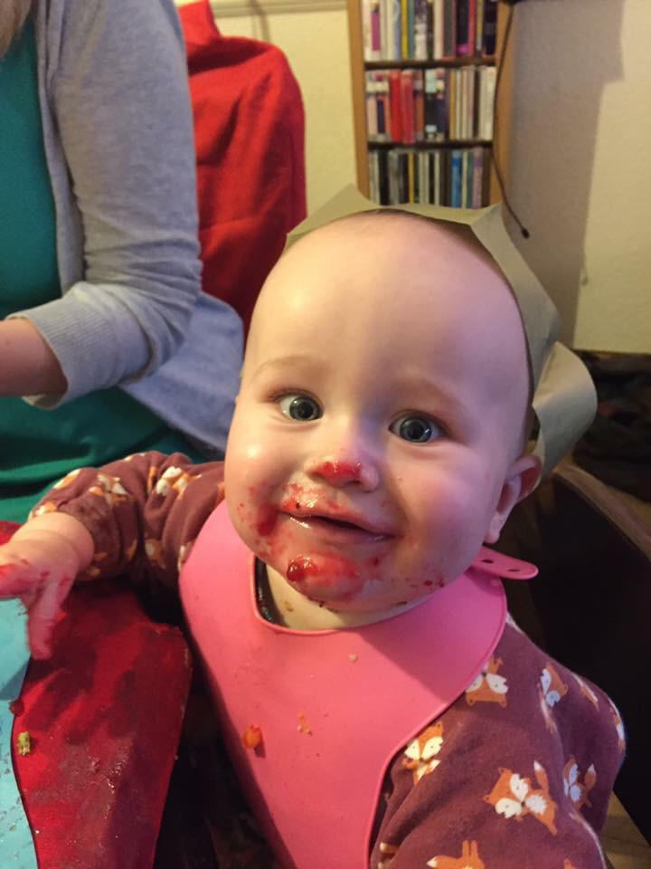 Dexter covered in cranberry sauce at Christmas time at seven months old