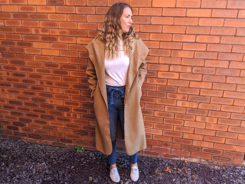 Femme luxe camel coat with paper bag jeans and white shirt