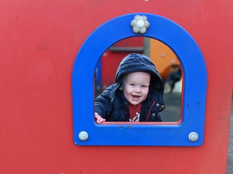 Felix peeking through some play equipment at Hesketh park