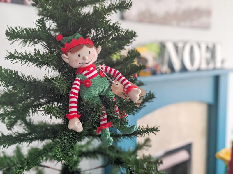 Elf for Christmas sat on the christmas tree