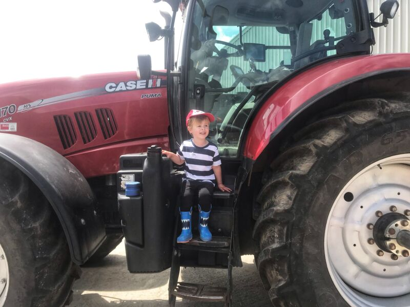 Deter sat on a red tractor on Leaf open farm day
