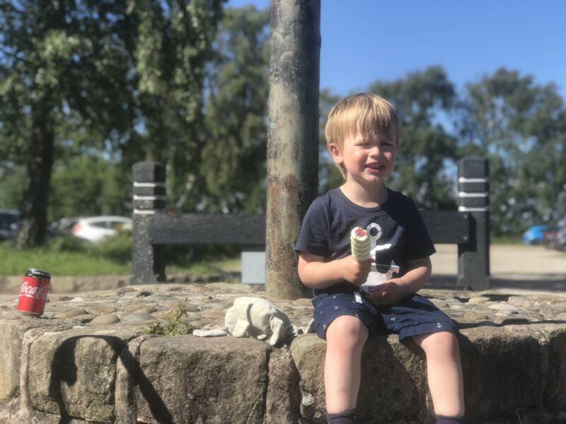 Dexter sat on a stone ledge with an ice lolly in his hand at martin mere