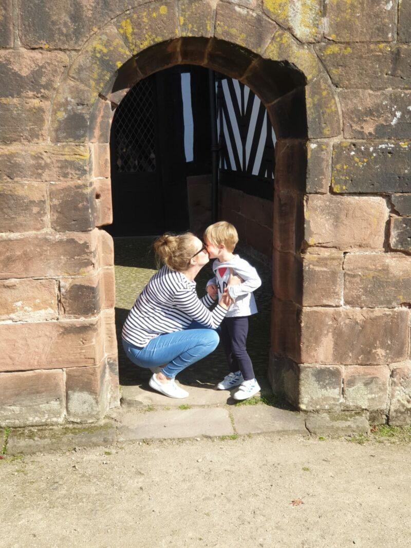 Dexter kissing his mummy in the stone doorway at speke hall