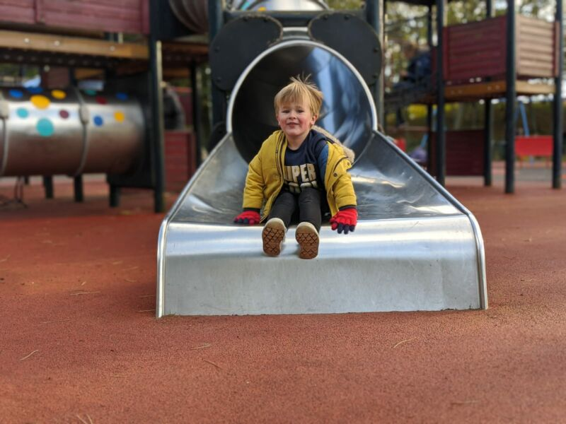 Dexter coming down silver slide in hesketh park