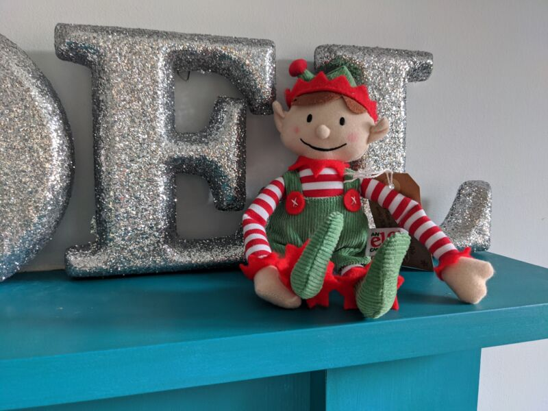 elf for christmas elf on our fireplace