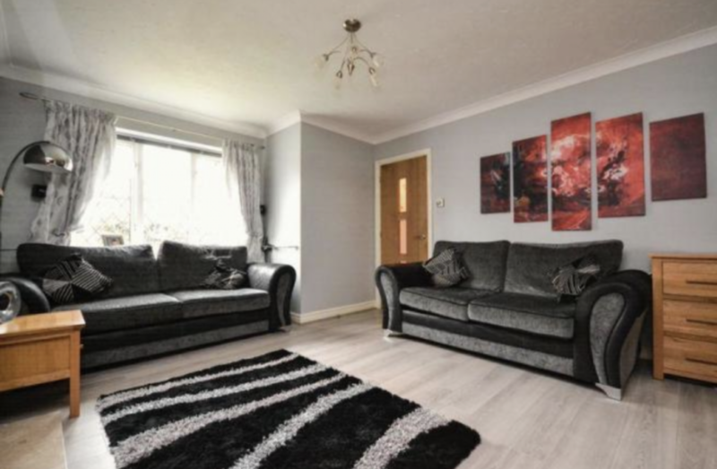 Our lounge before we moved in and made changes with icy blue walls and dark coloured furniture