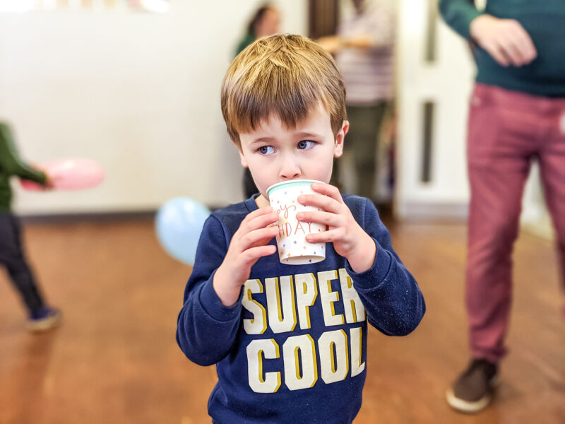 Dexter holding a cup at 4th birthday party