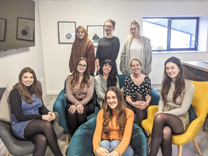 All the girls in work posing for International Women's Day