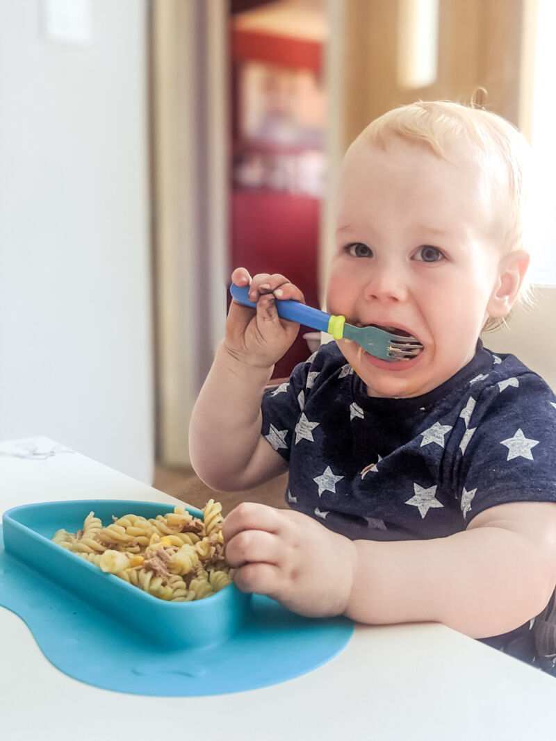 Felix enjoying the tuna pasta salad for babies - feeding himself with a fork