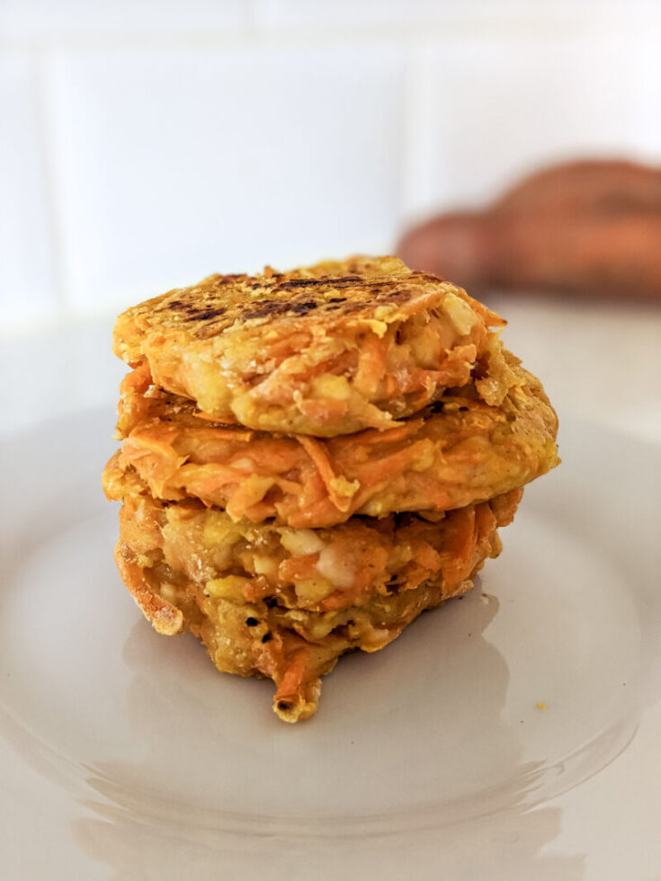 sweet potato hash browns stacked on a plate