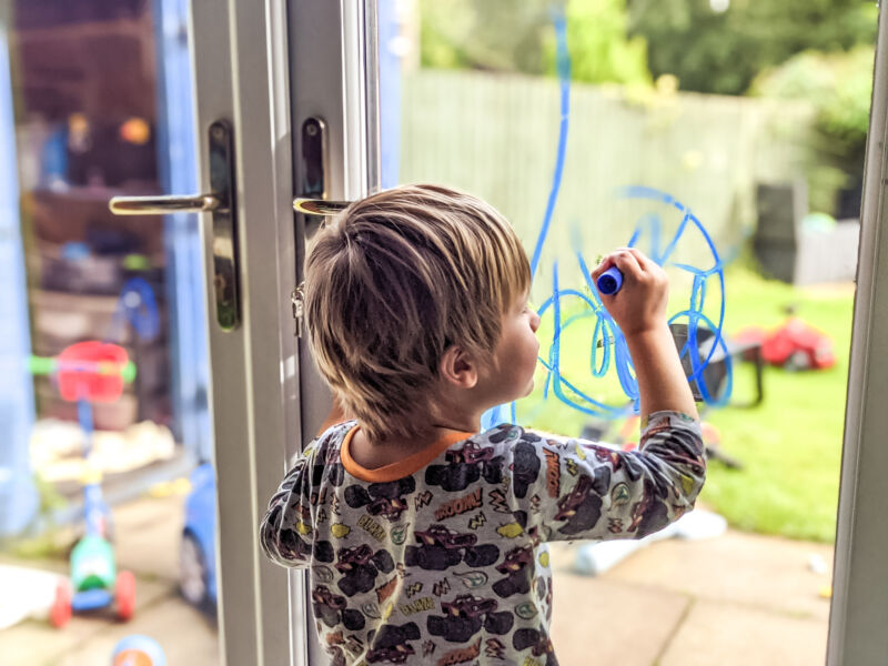 Dexter using Little Brian Paint Sticks on the window