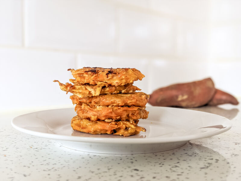 sweet potato fritters baby stacked on a plate
