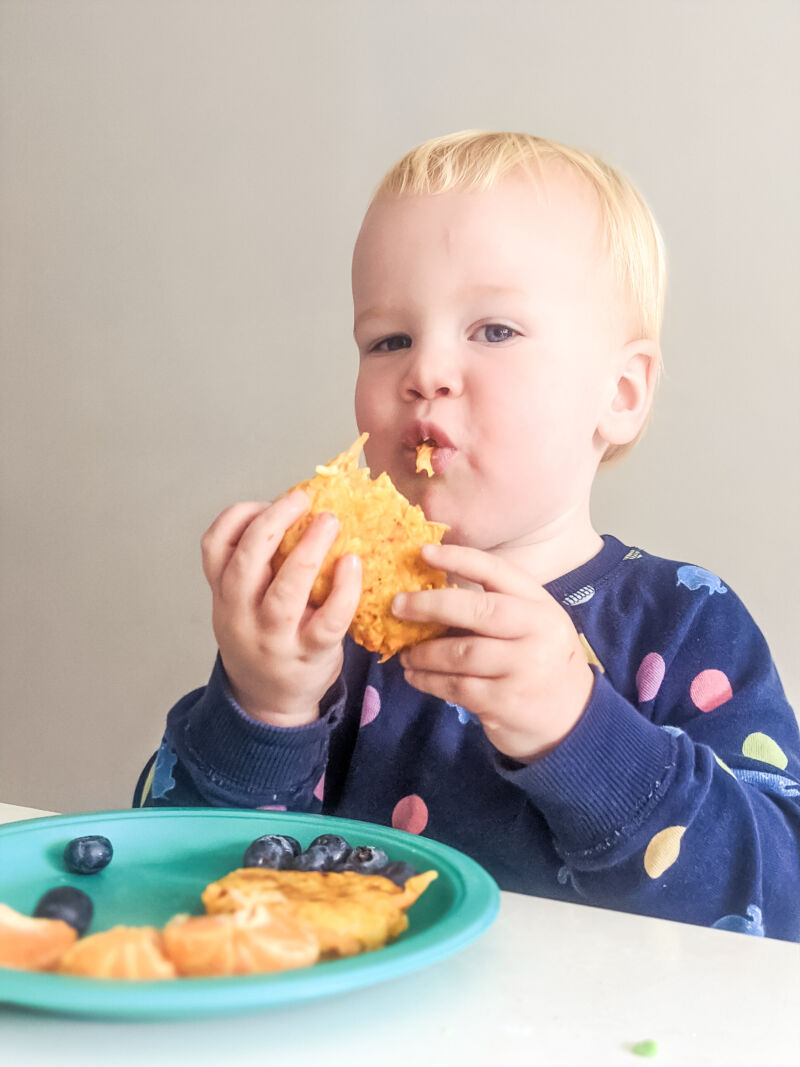 Felix eating the hash brown potato cakes