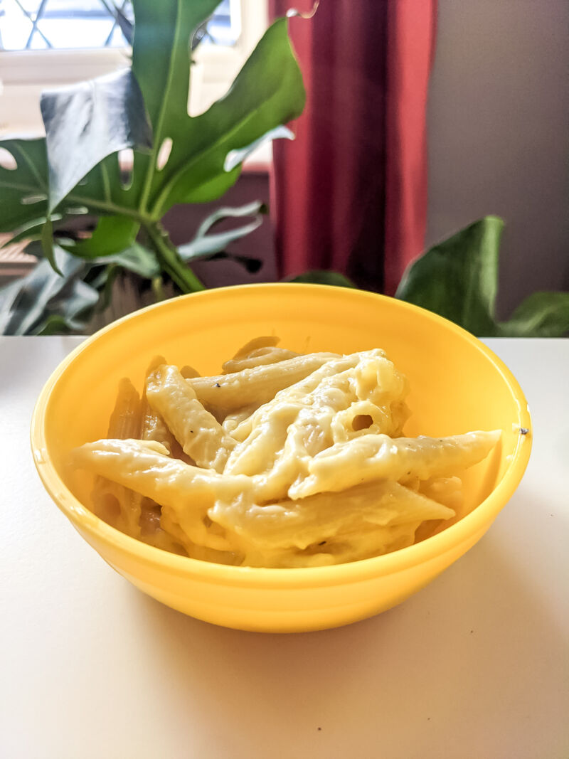 cheesy pumpkin pasta in a bowl