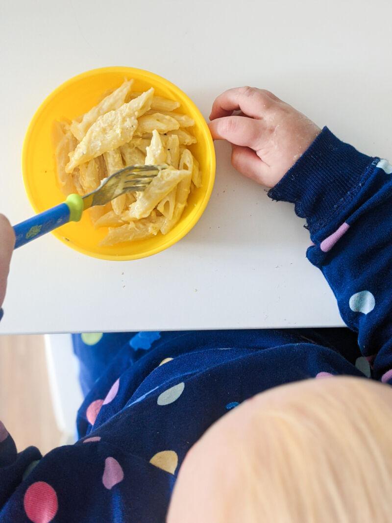 Felix eating the cheesy pumpkin pasta