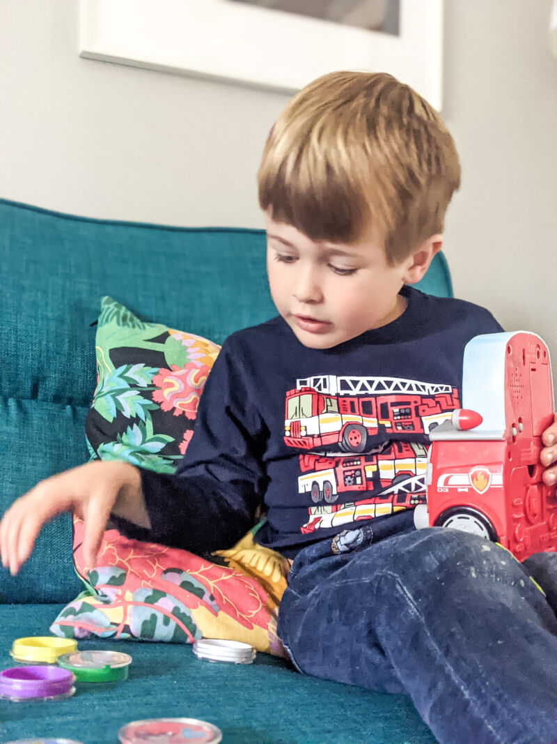Dexter playing with Paw Patrol count with marshall toy