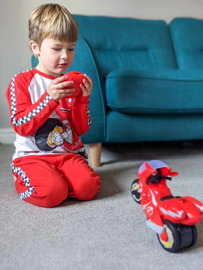 Dexter in Ricky Zoom pyjamas controlling Ricky Zoom Turbo Trick Ricky
