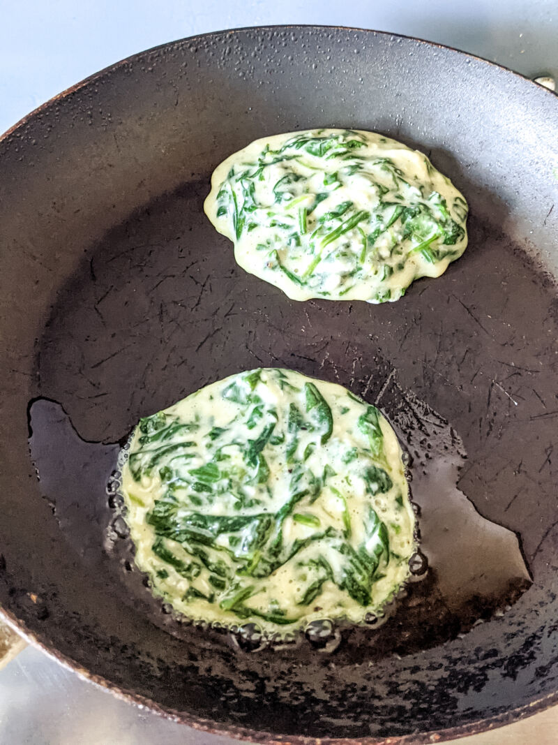 Spinach fritters for babies cooking in the pan