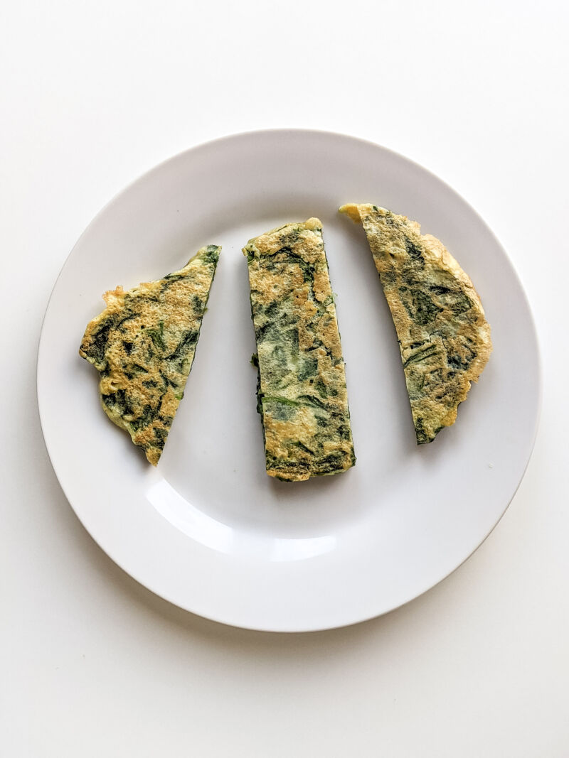 sliced spinach fritters ready for baby to eat