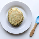 Broccoli fritters baby led weaning on white plate