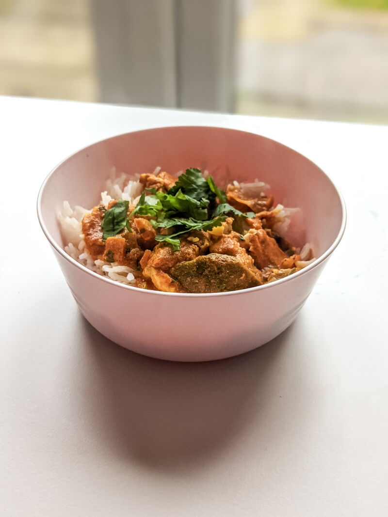 Baby curry in pink bowl
