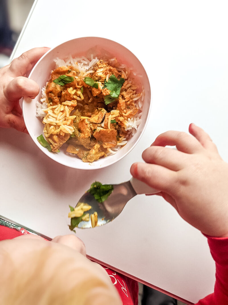 Baby curry Felix eating with Doddl spoon