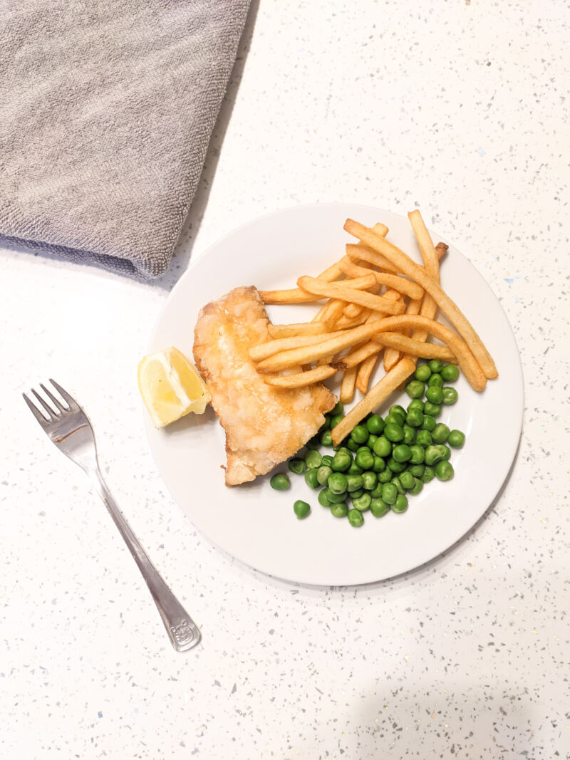 Fish and chips on a plate with a serviette