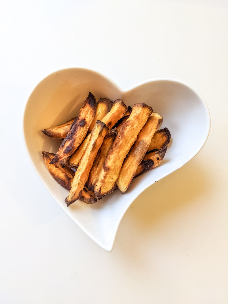 baby led weaning sweet potato fries in a heart shaped bowl