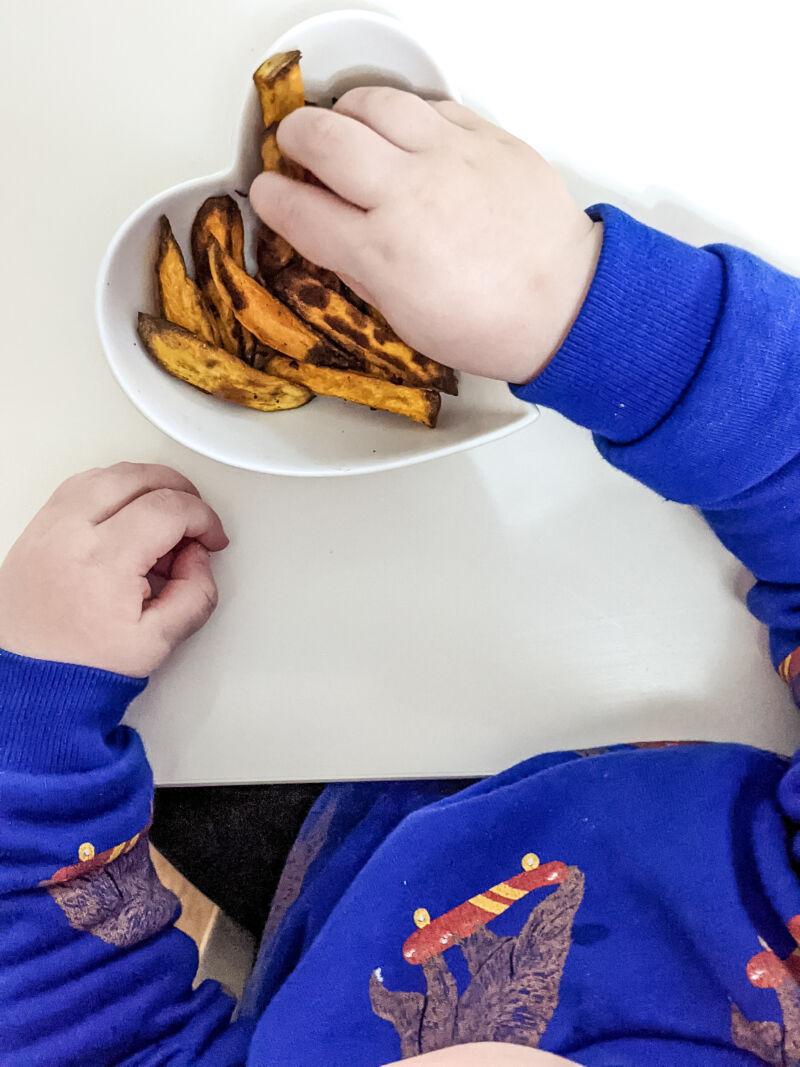felix eating baby led weaning sweet potato fries
