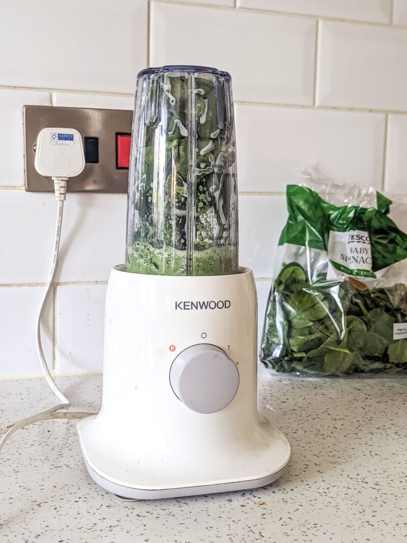 spinach and milk in the blender to create the green milk