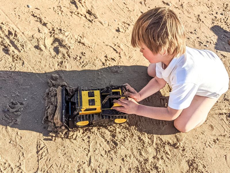 Dexter using the Tonka Steel Classics Bulldozer to move the sand