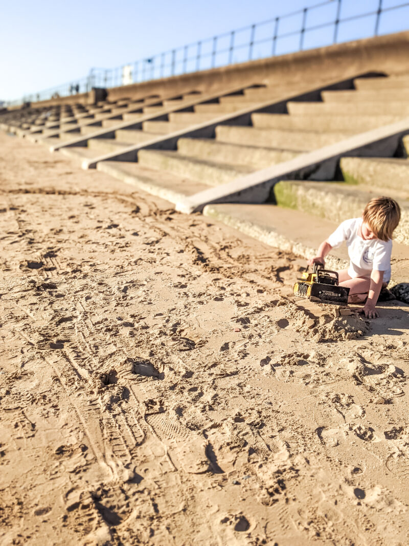 Dexter creating a pathway with the Tonka Steel Classics Bulldozer on the beach