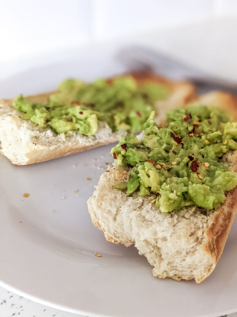 smashed avocado on baguette topped with chilli